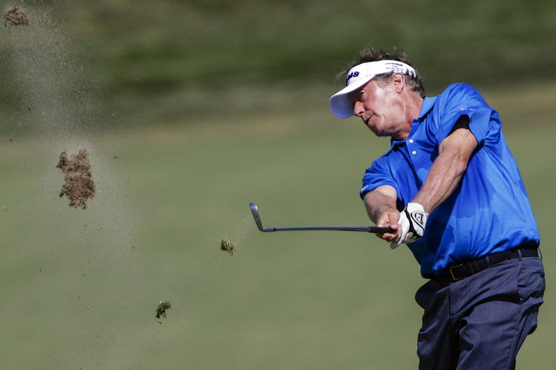 Michael Allen hits an approach shot on the ninth hole Friday during the second round of the U.S. Senior Open in Omaha, Neb. Allen opened a five-stroke lead with a 7-under 63.