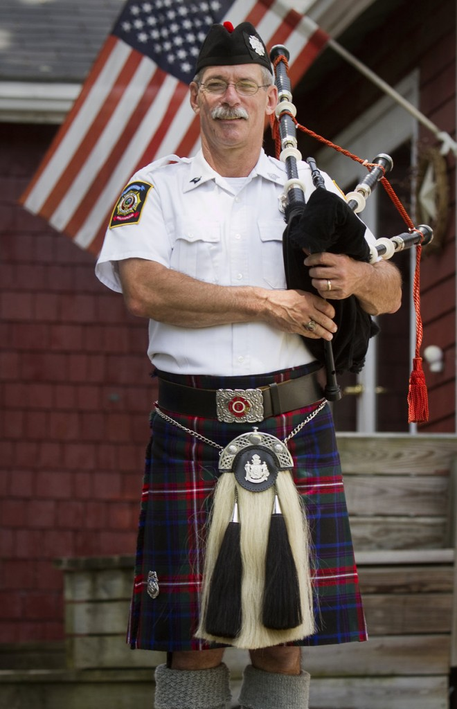 Rob Simmons, shown in uniform Saturday, has played at funerals for heroes who fell in the line of duty.