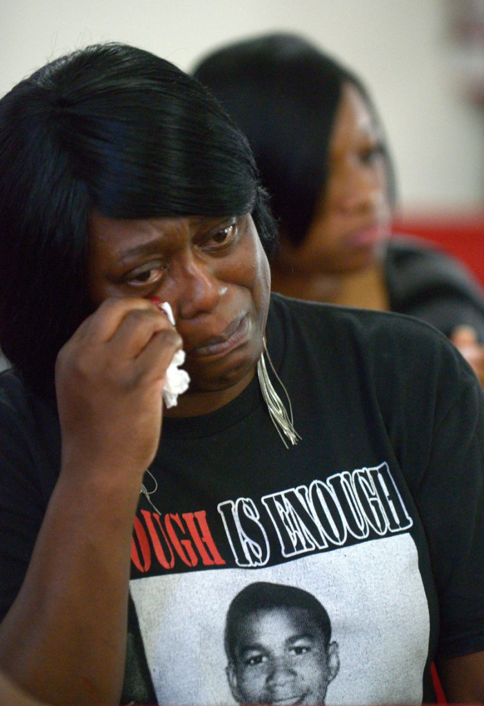 Nichole Mitchell wipes away tears during the sermon at a youth service at the St. Paul Missionary Baptist Church in Sanford, Fla., Sunday. Many in the congregation wore hooded sweat shirts to show support of Trayvon Martin.