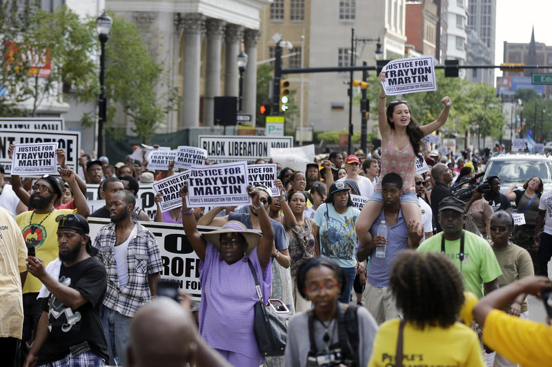 A large crowd marches along Broad Street, in Newark, N.J., Sunday to protest the acquittal in George Zimmerman's murder trial.
