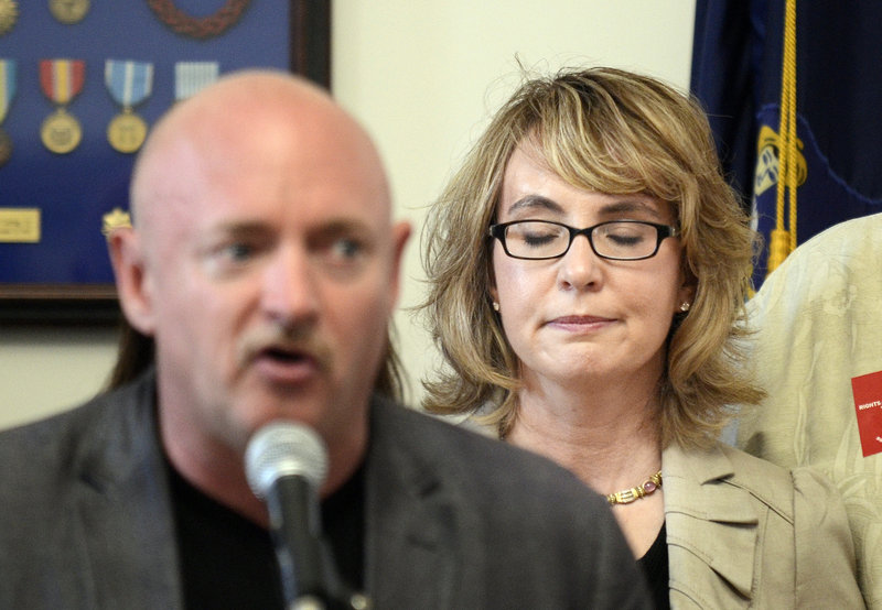 Ex-U.S. Rep. Gabrielle Giffords listens July 6 at Portland City Hall as her husband, Mark Kelly, describes the day Giffords was shot in 2011. A reader disagrees with Kelly's statement that gun registration won't lead to more gun restrictions.
