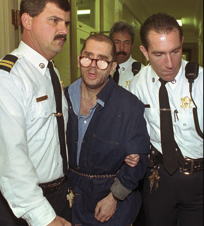 In this April 29, 1996 file photo, Lewis Lent Jr. is led from the Berkshire County Courthouse in Pittsfield, Mass., after a competency hearing was postponed. Massachusetts law enforcement authorities said Monday, July 15, 2013, that Lent, who is serving a life sentence for killing two children, also is responsible for the disappearance and death of James Lusher, 16, who was never seen again after leaving his Westfield, Mass., home on a bicycle ride in 1992. (AP Photo/Alan Solomon (AP Photo/Alan Solomon, File)