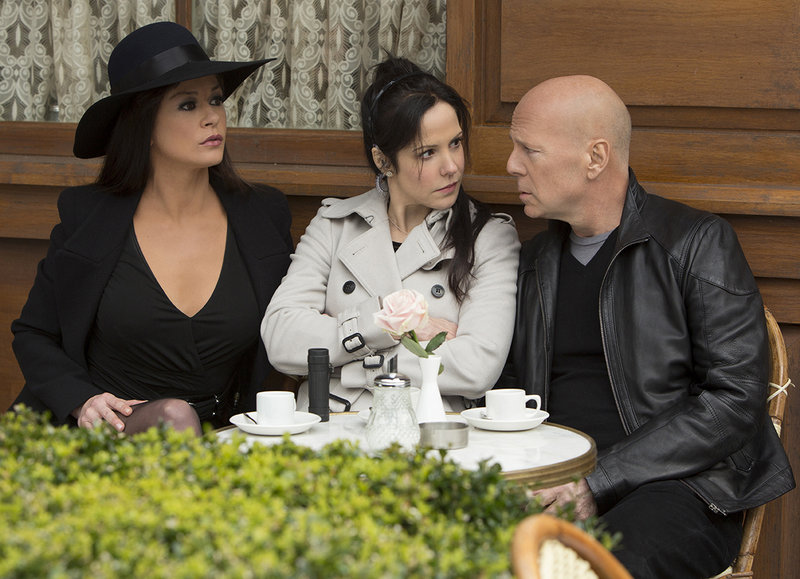 Catherine Zeta-Jones, Mary-Louise Parker and Bruce Willis in a scene from the action-comedy.