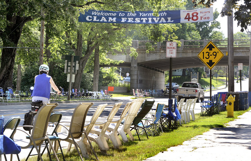 Yarmouth residents line Main Street with chairs for the Yarmouth Clam Festival. Photographed on Tuesday, July 16, 2013.