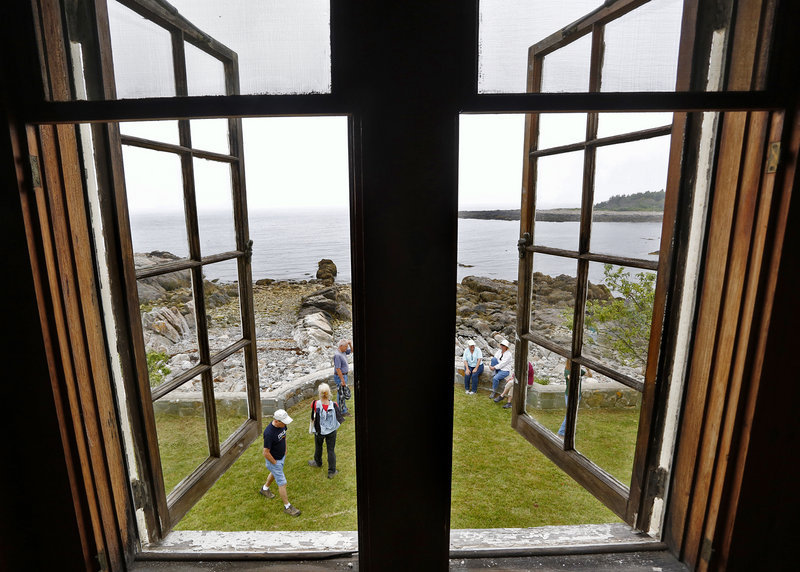 Visitors take a tour of the buildings at Timber Point in the Rachel Carson Wildlife Refuge in Biddeford. Allowing Timber Point Cottage to be a writers colony would be a tribute to Carson, an inspirational and gifted writer, a reader says.
