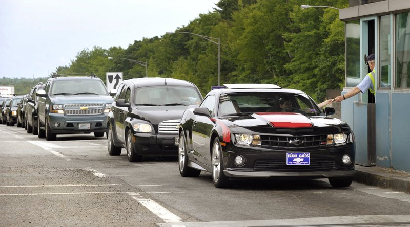 Drivers hand change to a toll collector as they exit the Maine Turnpike at the Falmouth Spur in 2012. On the turnpike as well as on Interstate 295 and local streets, the lines that guide motorists are disappearing, a reader says.