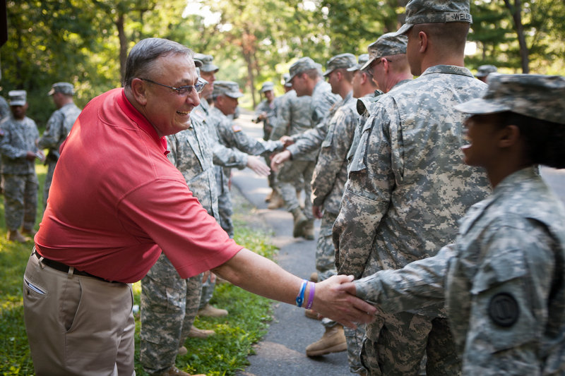 Maine Gov. Paul LePage greets Tonya Brasher of the Alabama National Guard after a ceremony for the 150th anniversary of Little Round Top attended by Guard units from the two states.