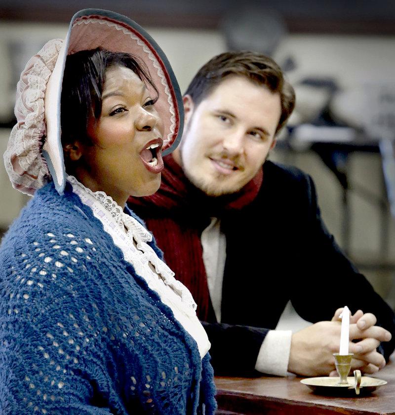 "Michelle Johnson as Mimi and Jeffrey Gwaltney as Rodolfo rehearse a scene from ""La Boheme."" The PORTopera production opens Wednesday at Merrill Auditorium."