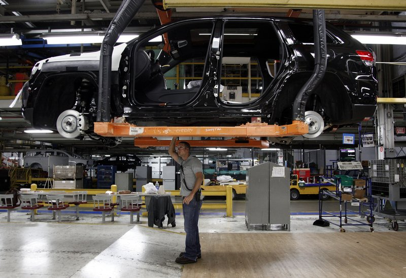 """Supervisor Jeff Caldwell checks a vehicle on the line at a Chrysler plant in Detroit. An AFL-CIO official is upset with the slow recovery. It's """"pathetic,"""" said Thea Lee. """"We're not even within spitting distance of full employment."""""""