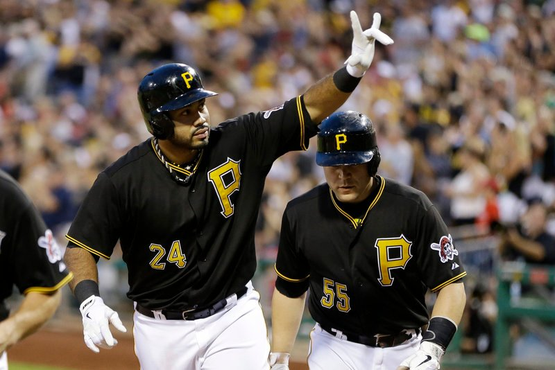 Pedro Alvarez, left, celebrates with teammate Russell Martin as they return to the dugout after another Pittsburgh Pirates victory. The longtime NL Central doormats are finally contending again.