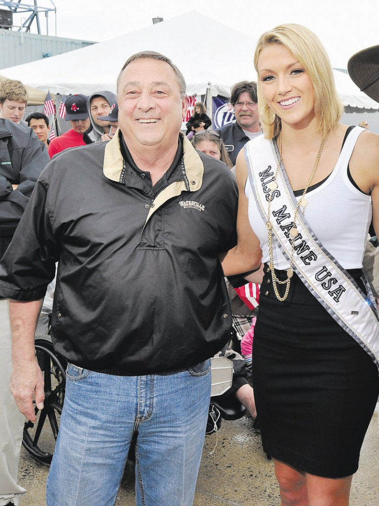 Gov. Paul LePage poses with Miss Maine USA Ashley Marble in 2011. He wanted to give her a job promoting education.