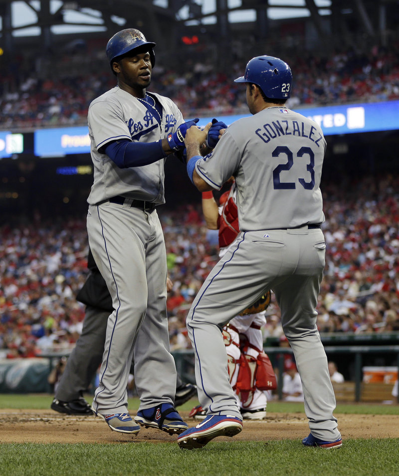The Dodgers' Hanley Ramirez, left, is greeted by Adrian Gonzalez after hitting a two-run homer in 3-2 win against the Nationals at Washington on Friday.