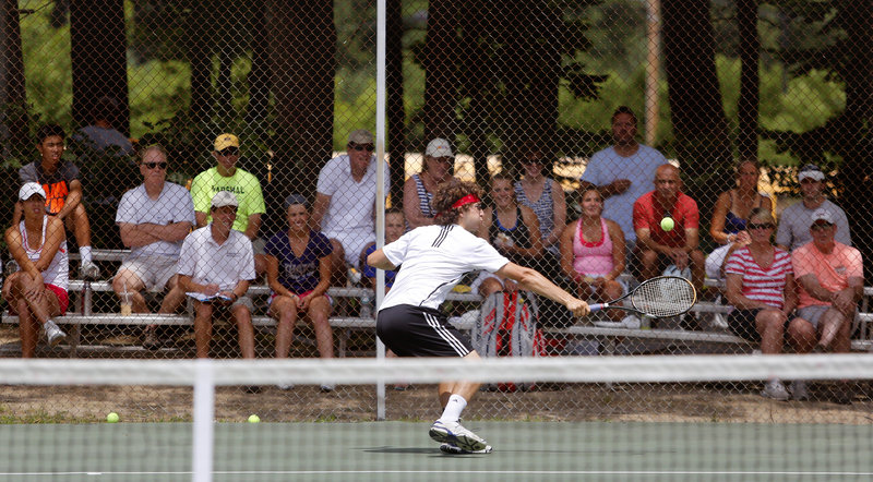 Noah Bragg of Brookline, Mass., makes a backhanded save against Luke Saunders of Halifax, Nova Scotia, en route to the men's singles title Sunday afternoon at the Yarmouth High School courts – an event that attracted 226 players and was held at five sites for the six tournament brackets.