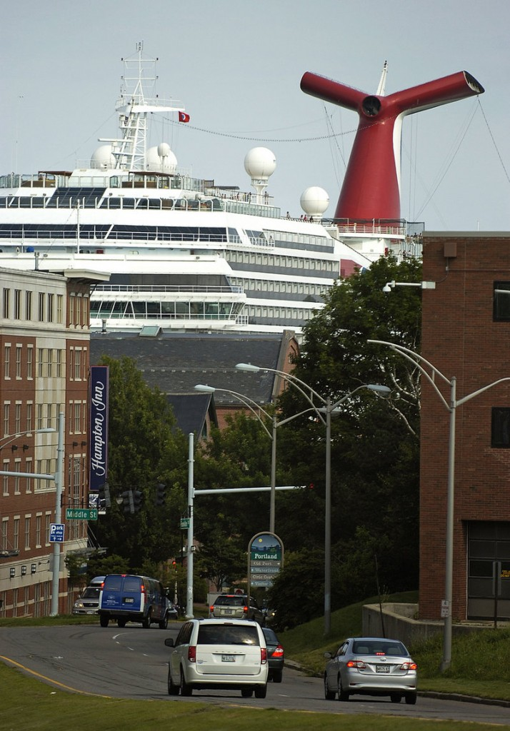 The Carnival Glory towers over the Portland waterfront Monday in this view from the corner of Franklin and Congress streets. The ship has a capacity of 2,984 passengers and a crew of 1,150, according to Carnival Cruise Lines.
