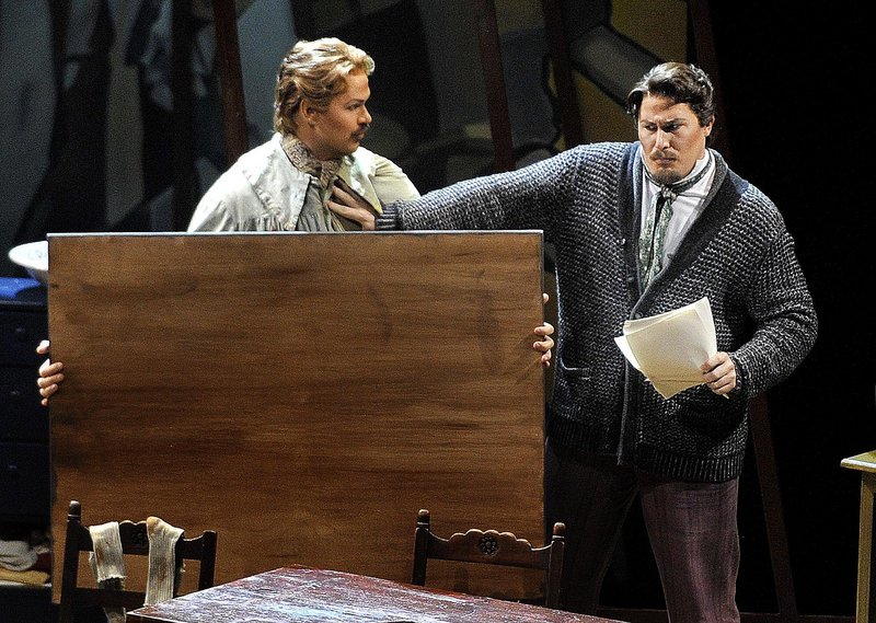 """Edward Parks, in the role of Marcello, is held off by Jeff Gwaltney, as Rodolfo, in the opening performance of Puccini's """"La Boheme"""" at Merrill Auditorium in Portland on Wednesday. Director Dona D. Vaughn gives the opera a contemporary feel."""