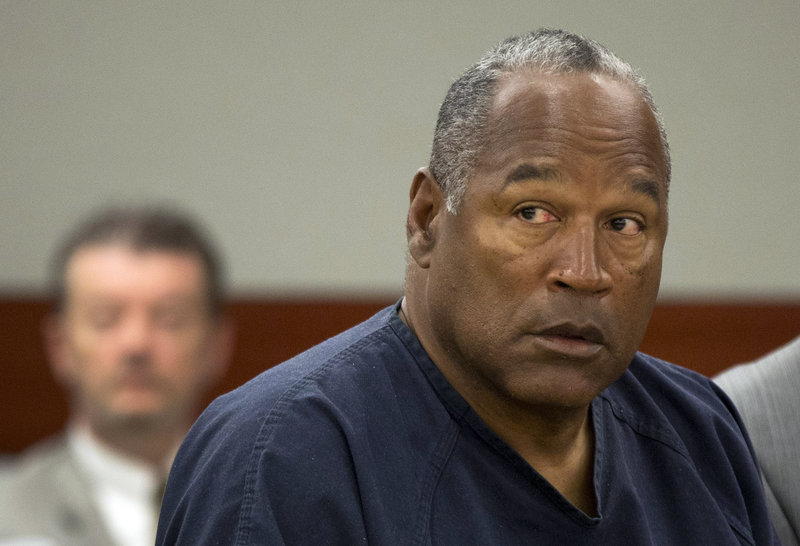 """O.J. Simpson told a parole panel Thursday that he's been a model inmate and that his crime was """"trying to retrieve for my family my own property."""""""