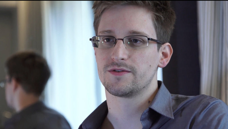 Edward Snowden seeks temporary asylum in Russia, while U.S. authorities want him sent home to face three charges, including espionage.