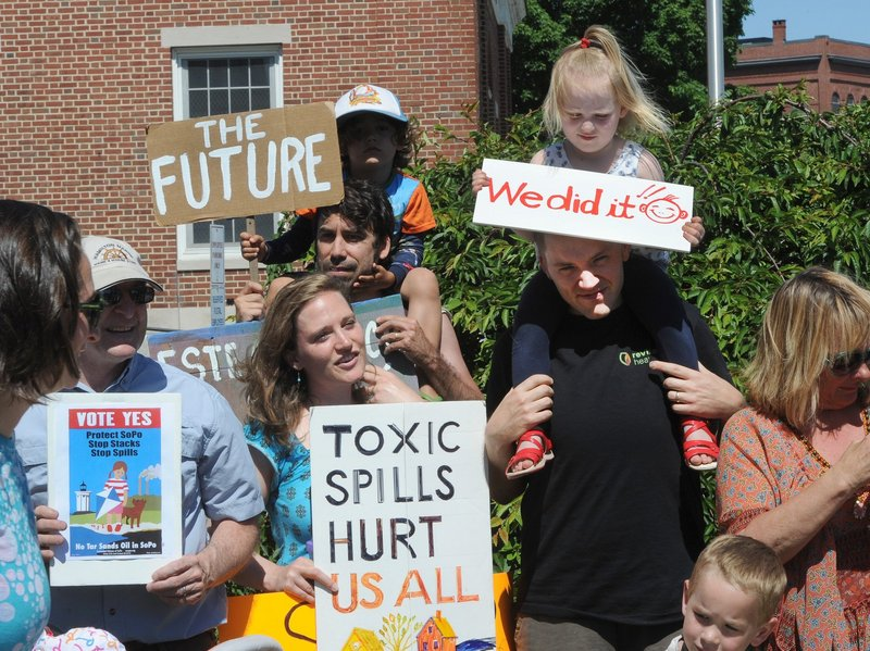 Members of the Concerned Citizens of South Portland attend a June news conference after collecting enough signatures to get a referendum on the ballot to block the passage of so-called tar sands oil through the city.