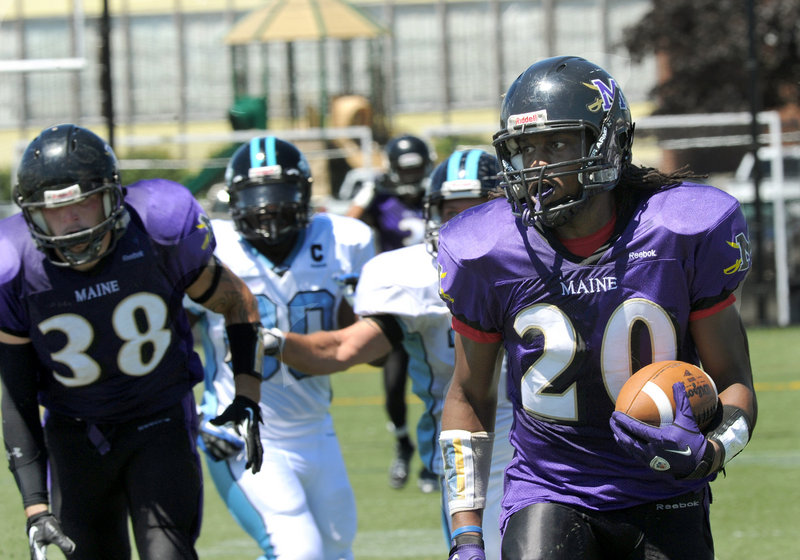 Tony Hicks scores on a 65-yard punt return during the Maine Sabers' 28-6 victory over the New Hampshire Wolfpack in a New England Football League game Saturday.