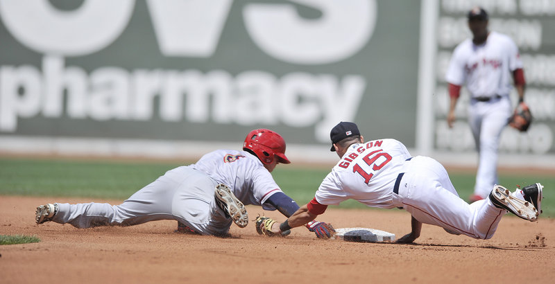 Derrik Gibson of the Sea Dogs comes up just short with a diving tag Saturday as Ricky Hague of the Harrisburg Senators reaches on a two-base error. The Sea Dogs came away with a 5-2 victory at Fenway Park.