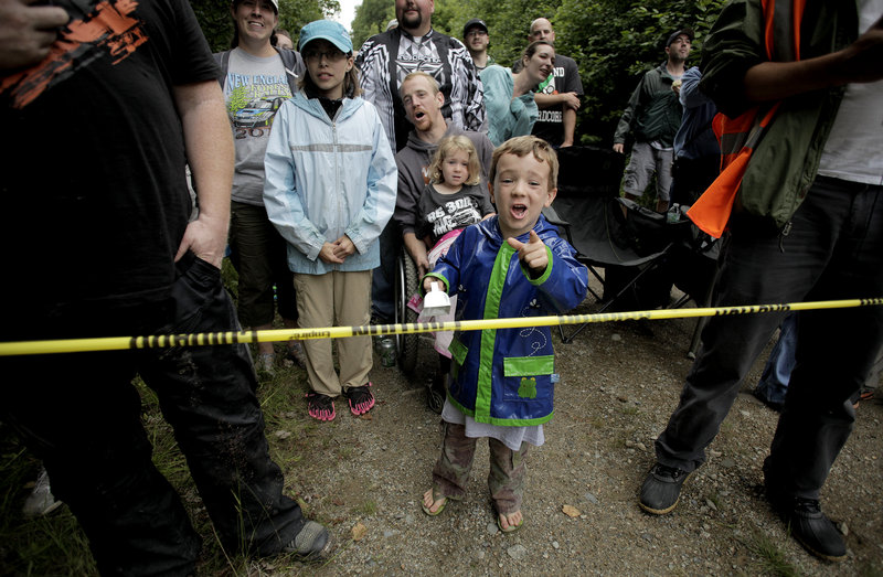 Aiden Gardner Baker, 5, cheers as he and other spectators watch racers during the Icicle Brook Stage on Friday.