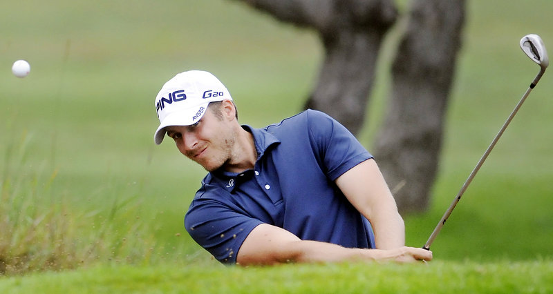 Jesse Speirs, a Bangor native and pro, drives out of a bunker on the first day of the Maine Open at the Augusta Country Club in Manchester. Speirs was three shots off the lead after shooting a 68.