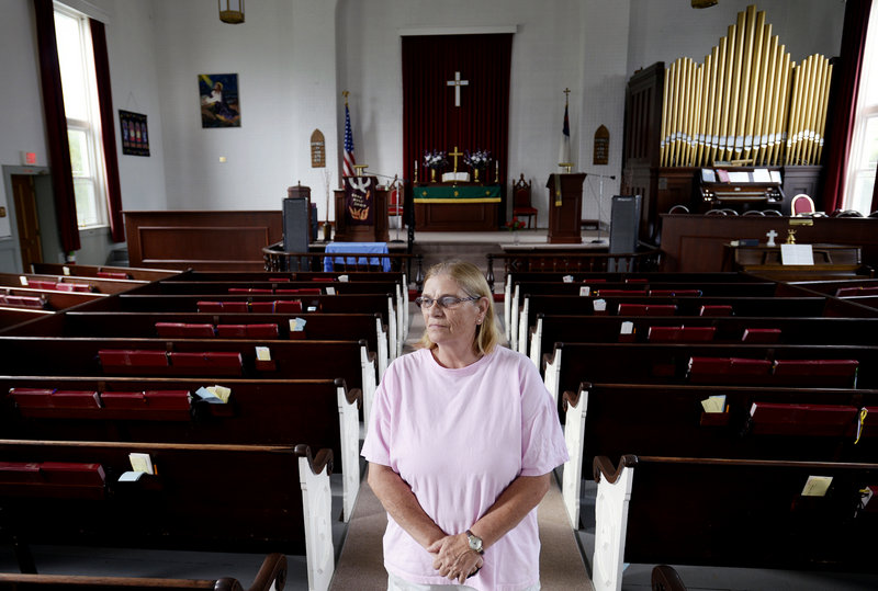 Sharon Ward, historian at First United Methodist Church in South Portland, says when she was a child, Sunday service used to attract as many as 150 parishioners; these days, 20 congregants is a good showing for worship.
