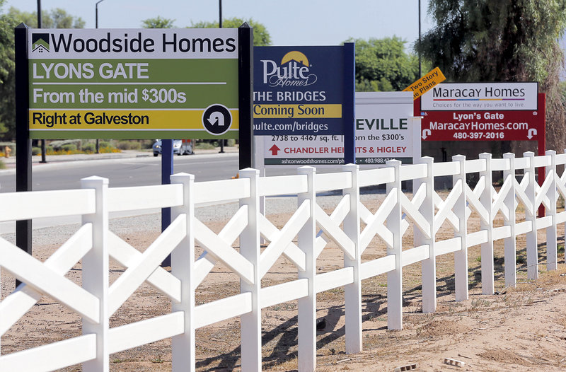 Home builders advertise Tuesday in Gilbert, Ariz. Home prices jumped 12.2 percent in May compared with a year ago, the biggest gain since March 2006. The biggest price gains are occurring in states that experienced the worst housing bust.