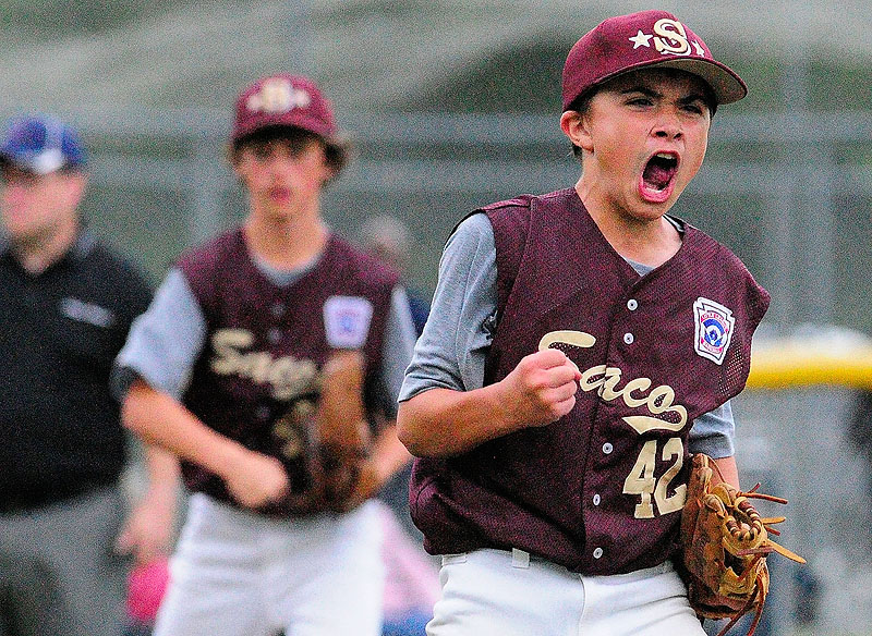 Saco pitcher Luke Chessie celebrates after his team beat Bayside 14-1 to win the Maine State 11/12 Little League championship game on Friday at Linscott Field in Augusta,