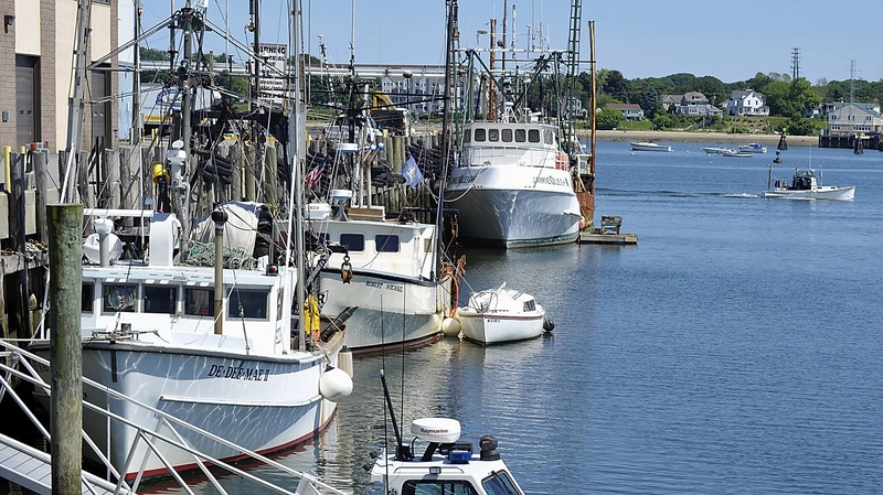 In this 2012 file photo, a lobster boat passes by fishing boats in Portland. Maine fishermen were told at a Portland symposium Wednesday, July 31, 2013 that they'll have to be better informed and more flexible if they are to survive the changes that a warming climate is bringing to Gulf of Maine fisheries.