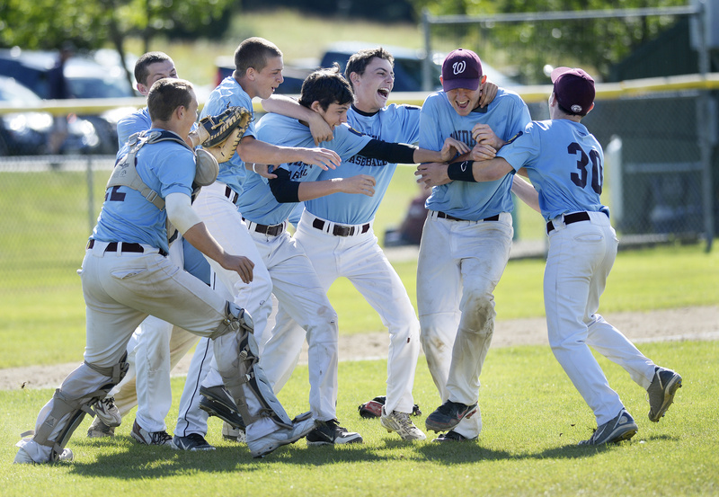 Windham players celebrate their state championship victory in American Legion Baseball after they defeated Westbrook on Monday.