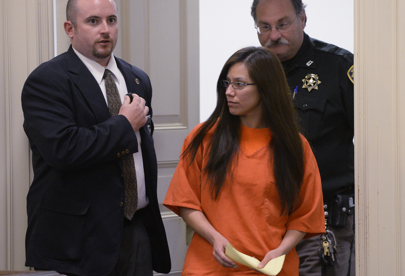 Alexis Wright is escorted into York County Superior Court in Alfred on Thursday.
