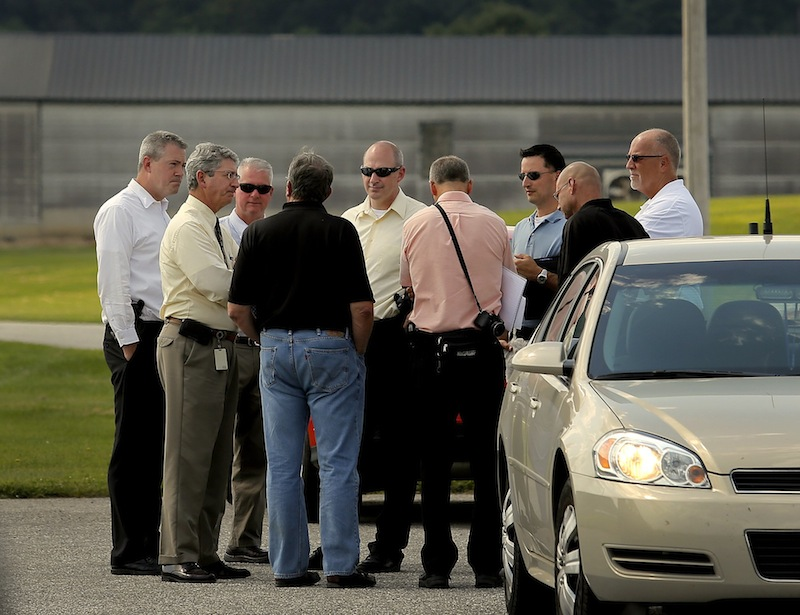 State police investigators and Deputy Attorney General William Stokes met with officials from Moark Egg Farm at its Turner location Tuesday, August 20, 2013, after a man was accidentally shot and killed by a co-worker who was shooting rodents and stray chickens.