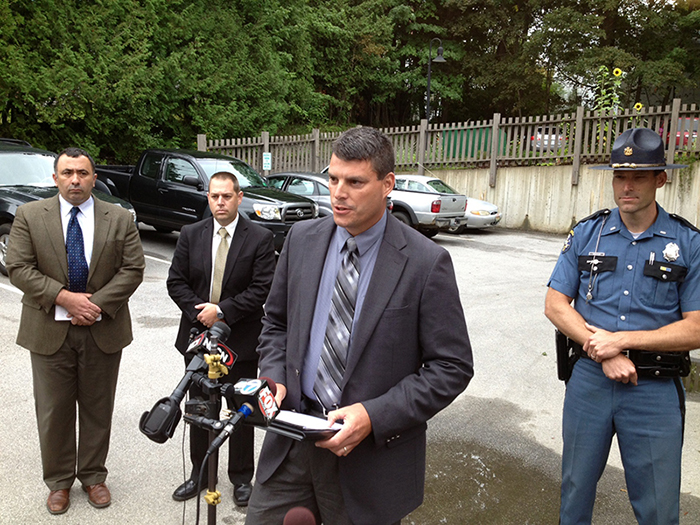 Belfast Police Chief Michael McFadden, left, Maine State Police Sgt. Jason Richards; State Police Lt. Christopher Coleman, speaking; and State Police Lt. Aaron Hayden speak to the press Thursday following the shooting that left one woman dead and her son critically injured. Police have arrested the suspect, Todd Gilday, 44, of Belfast.