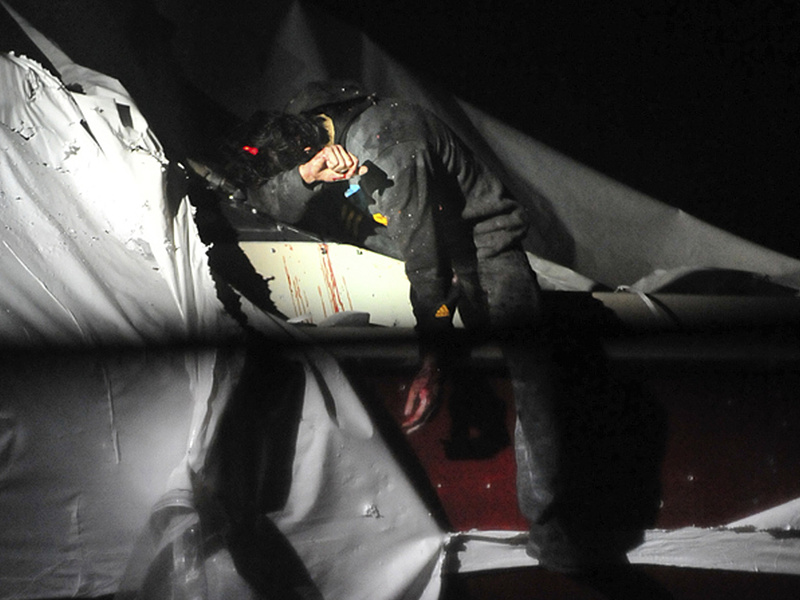 Boston Marathon bombing suspect Dzhokhar Tsarnaev leans over in a boat at the time of his capture by law enforcement authorities on April 19 in Watertown, Mass.