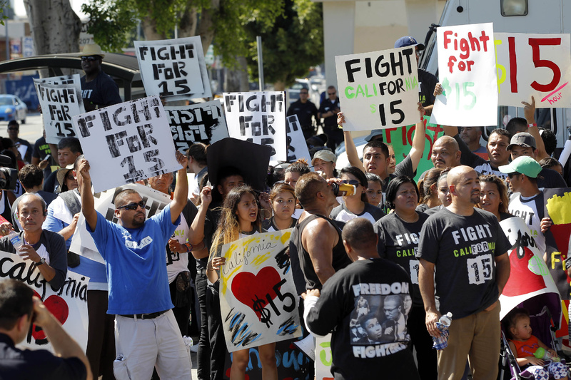Protesters demonstrate outside a fast-food restaurant on Thursday in Los Angeles. Fast-food protests were under way Thursday in U.S. cities, including New York, Chicago and Detroit, with organizers expecting the biggest national walkouts yet in a demand for higher wages.