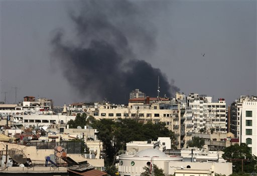 Columns of smoke rise from heavy shelling in the Jobar neighborhood, east of Damascus Sunday. Syria reached an agreement with the United Nations to allow a U.N. team of experts to visit the site of alleged chemical weapons attacks last week outside Damascus, state media said.