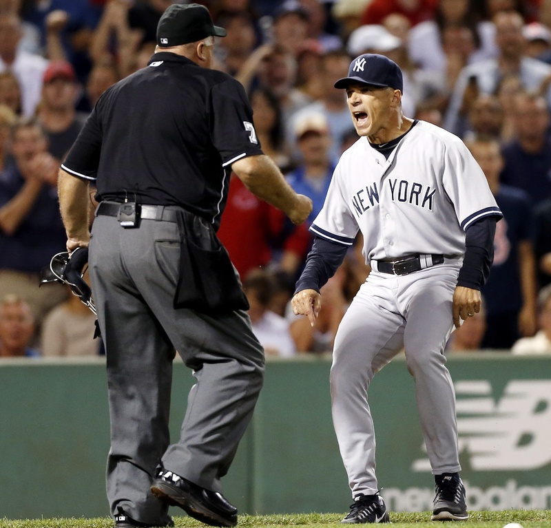 New York Yankees manager Joe Girardi, right, argues with home plate umpire Brian O'Nora after Alex Rodriguez was hit by a pitch in the second inning of a baseball game in Boston on Sunday. Girardi is still mad.