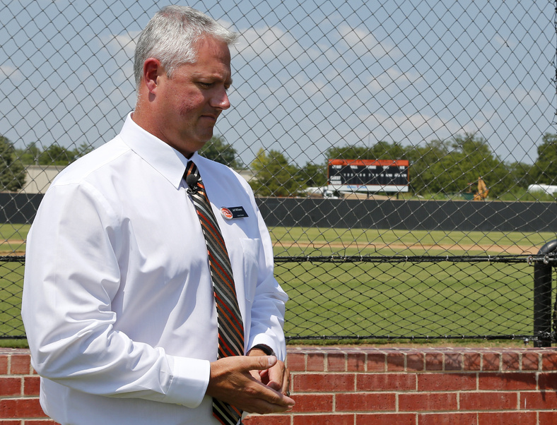 Jeff Williams, director of athletics at East Central University, prepares to talk about Chris Lane during an interview at the baseball field at East Central University in Ada, Okla., on Wednesday. Lane attended the school on a baseball scholarship.