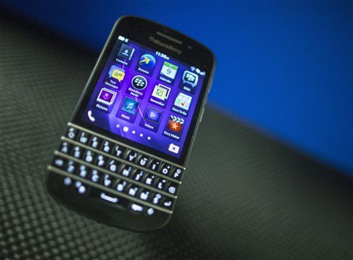 A BlackBerry Q10 is displayed recently at a company' meeting, in Waterloo, Ontario. Struggling smartphone maker BlackBerry will consider selling itself. The Canadian company is exploring