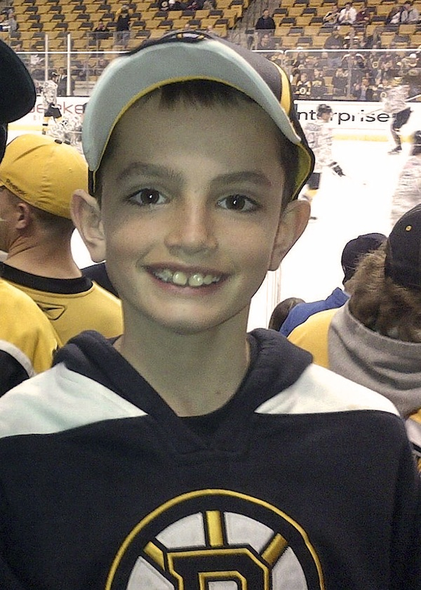 """This April 11, 2013 photo provided by the Richard family shows, Martin Richard, 8, in Boston, the youngest of three people killed in the bombings, Monday, April 15, 2013, near the finish line of the Boston Marathon.The family of Martin and his sister Jane, 7, who lost part of her left leg in the blast, released a photo Thursday, Aug. 15, 2013 showing her walking on a prosthetic leg, and said in a statement that she is already dancing and """"struts around on it with great pride."""" (AP Photo/Bill Richard, File)"""