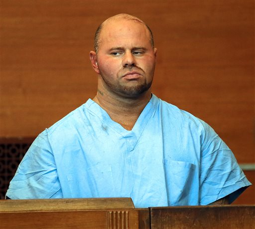 Jared Remy appears at Waltham District Court for his arraignment on Friday in Waltham, Mass. He is being held without bail after pleading not guilty to fatally stabbing his girlfriend, 27-year-old Jennifer Martel, at his home.