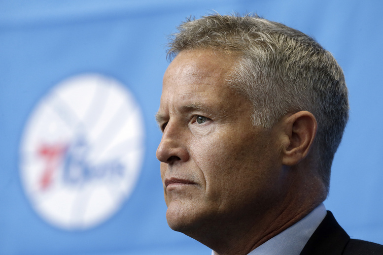 Philadelphia 76ers incoming head coach Brett Brown listens during a news conference introducing him as head coach Wednesday in Philadelphia. Brown's hire ended a four-month search to replace Doug Collins.