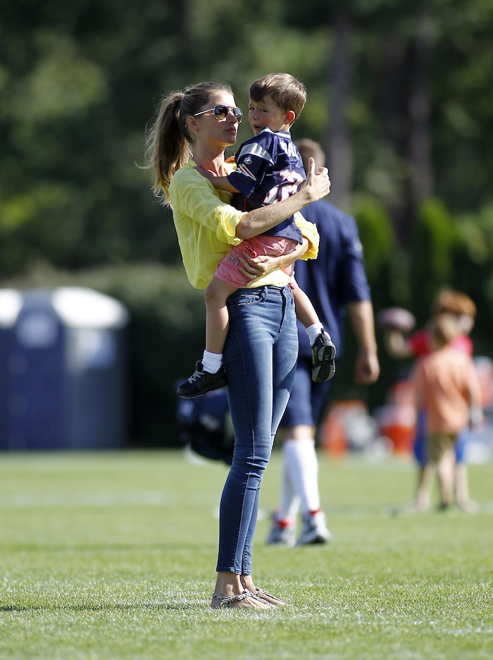 Gisele Bundchen comforts her son Benjamin after he was hurt playing football, following a joint workout with the Tampa Bay Buccaneers and the New England Patriots at NFL football training camp, in Foxborough, Mass., Thursday.
