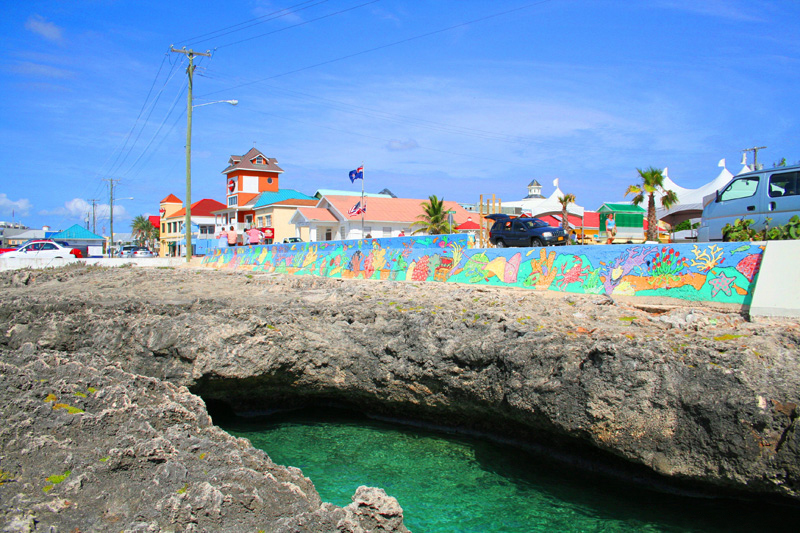 A file photo of a waterfront street in George Town, Cayman Islands. The Cayman Islands says it has reached agreement with the United States to provide information on accounts held by American citizens to comply with a sweeping U.S. law designed to combat tax evasion.