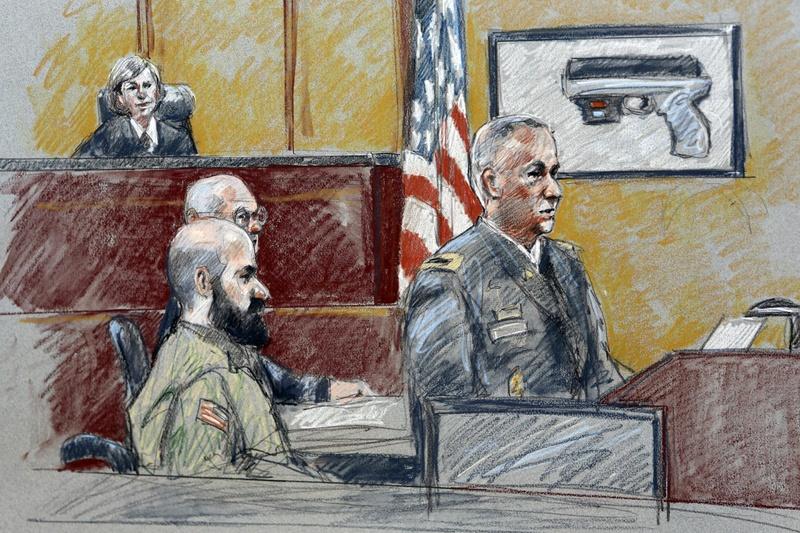 Military prosecutor Col. Steve Henricks, right, speaks as Nidal Malik Hasan, center, and presiding judge Col. Tara Osborn look on during Hasan's court-martial in Forth Hood, Texas.