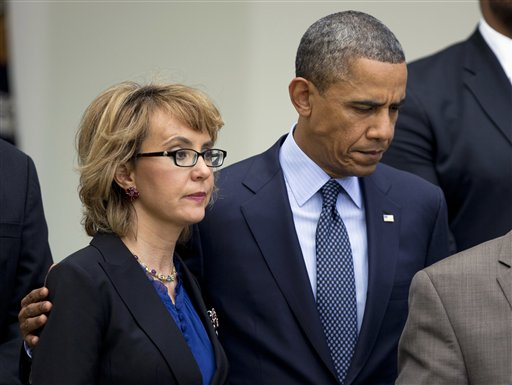 In this April 17, 2013, photo, President Barack Obama puts his arm around former Arizona Rep. Gabrielle Giffords before speaking in the Rose Garden about measures to reduce gun violence.