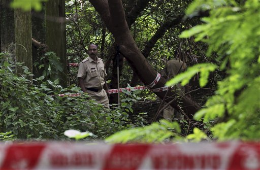Indian policemen inspect the site where a 22-year-old woman was gang raped in Mahalaxmi area in Mumbai, India.