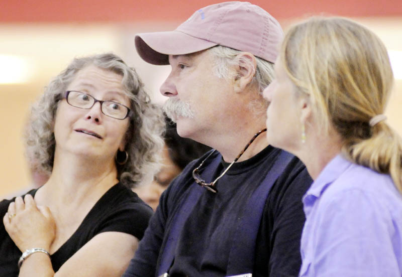 Lisa, left, and Ralph Turner of Laughing Stock Farm in Freeport and Jan Goranson of Goranson Farm in Dresden listen to Food and Drug Administration Deputy Commissioner of Food Safety Michael Taylor speak Monday in Augusta about new rules for farmers to reduce food-borne illness.