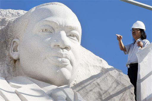 Sculptor Lei Yixin surveys the Martin Luther King Jr. Memorial in Washington to prepare for removal of the